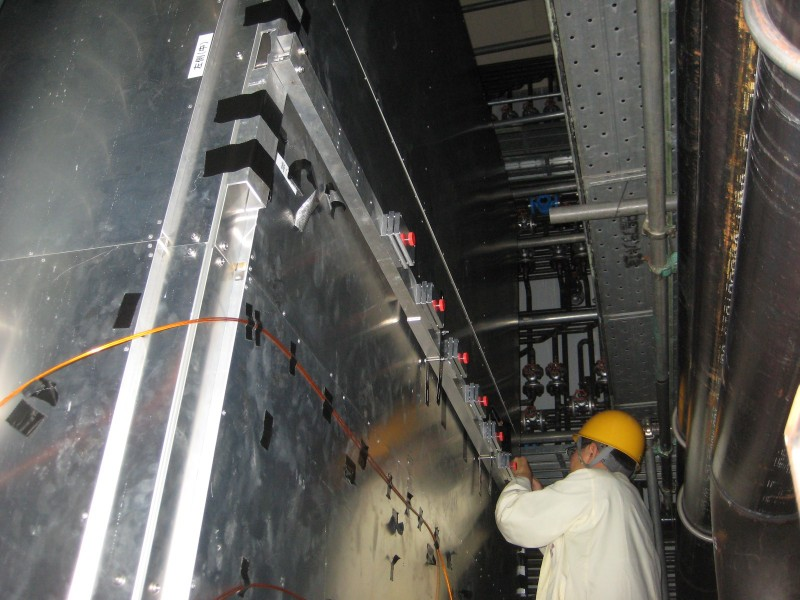 A physicist from Bern working at the installation of the muon monitor of the T2K