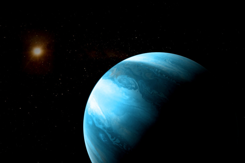 Artist's impression of a jupiter-like planet with a blueish colour orbitin