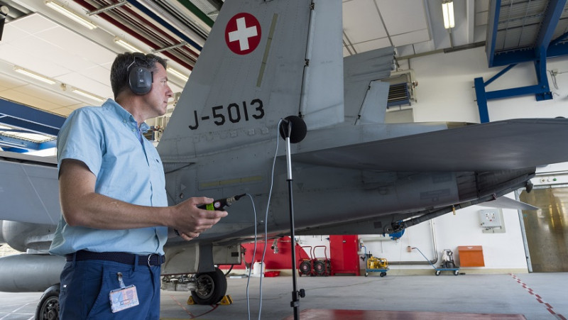 Jean-Marc Wunderli doing noise measurements of fighter jets at Payerne airfield.