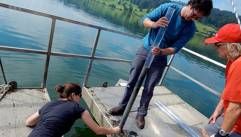 Marie-Eve Monchamp and her team taking sediment cores in Hallwilersee.