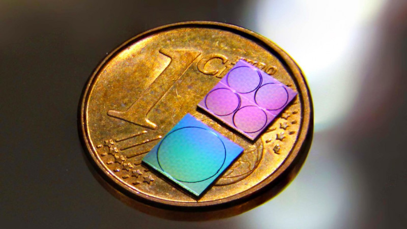 Photograph of the silicon nitride photonic chips used for frequency comb and pho