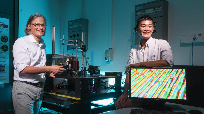 Dirk Grundler and doctoral assistant Sho Watanabe with a broadband spin-wave spe