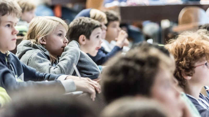 Attentive listeners in a lecture at the Children's University of Zurich.