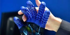 The glove of the soft robot hand are made using Spectroplast's silicone printing
