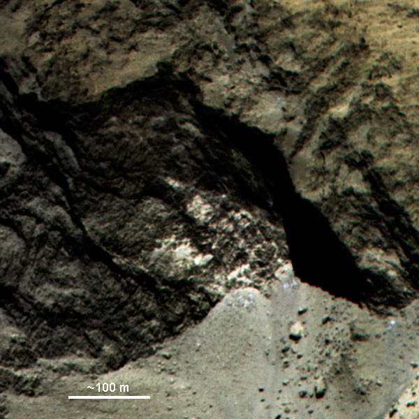 Colour composit of a part of 67P. The rocky surface contains remarkably light st