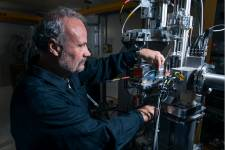 Physicist Martin Grossmann checks a security element in the beam path behind the
