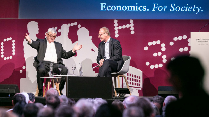 Ernst Fehr talks to Joschka Fischer, former Foreign Minister of Germany, at a pu
